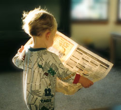 Kid_reading_newspaper